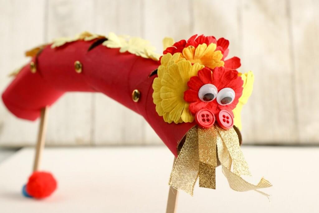 Looking for Chinese New Year kids crafts? Learn how to make this Chinese New Year dragon puppet by top Seattle mom blog Marcie in Mommyland
