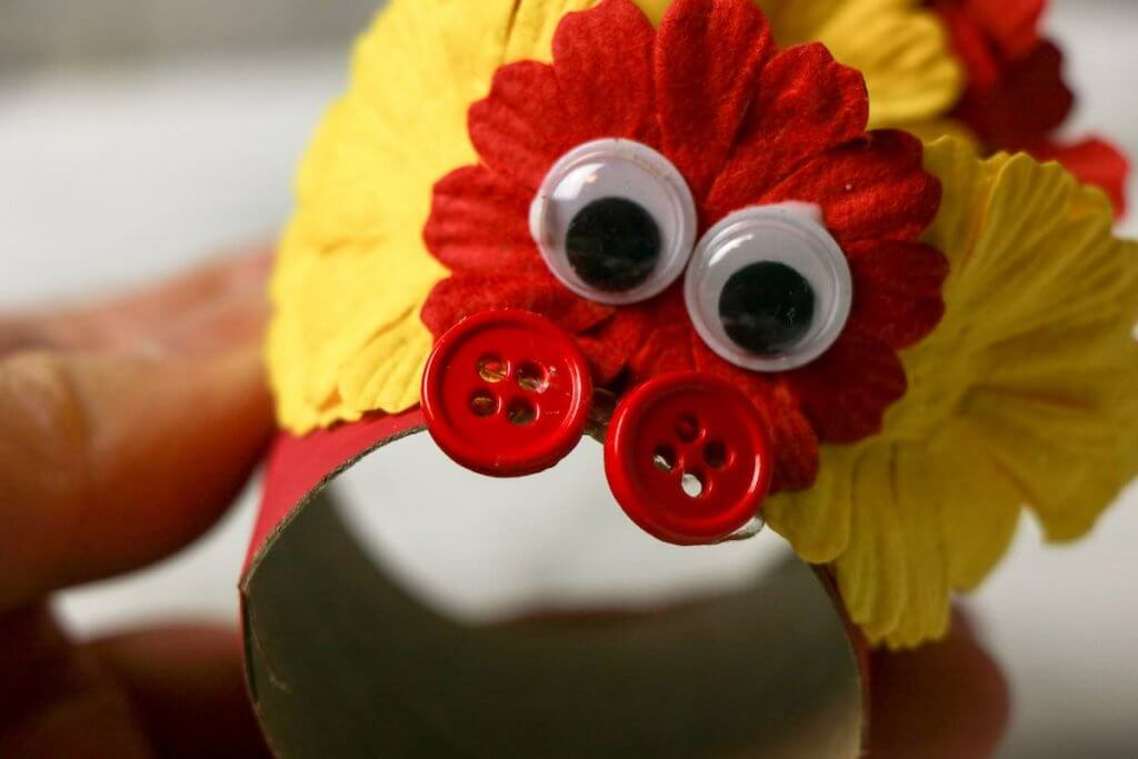 Decorate these Chinese Dragon Puppets with googly eyes, flowers, and buttons.