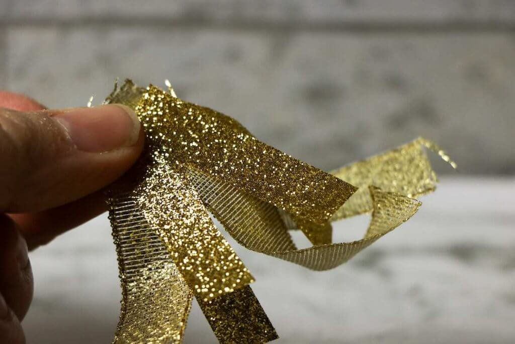 Cut a bunch of gold ribbon to create the dragon flames coming from your Chinese New Year dragon craft.
