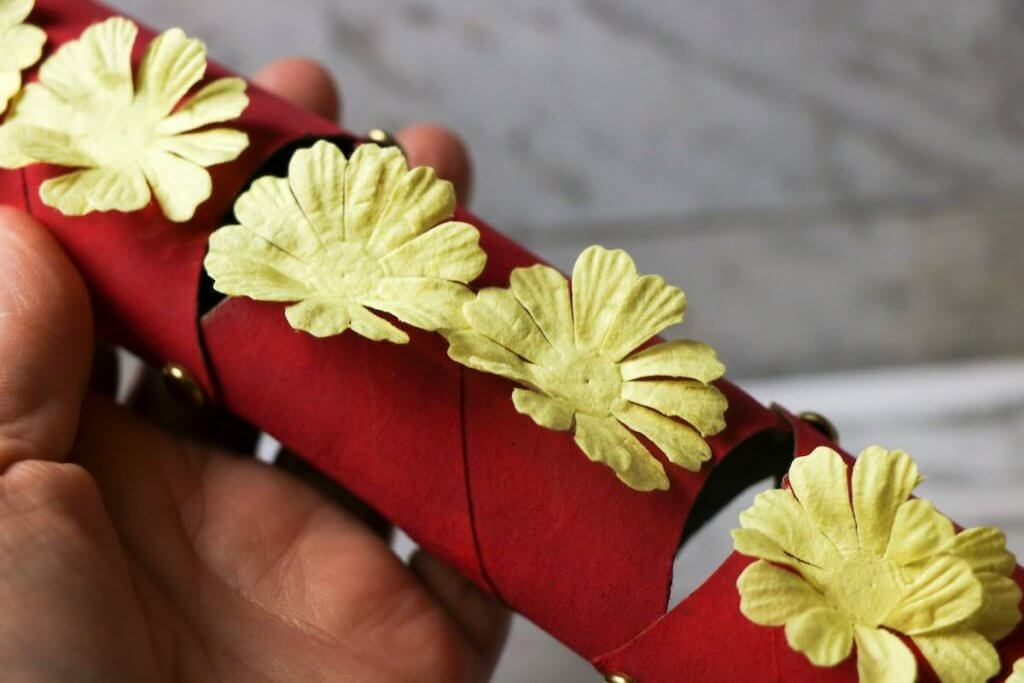 Decorate your Chinese New Year dragon puppet with paper flowers.