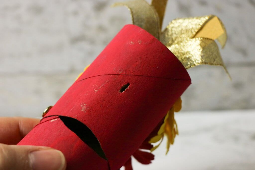 Cut a small slice into the paper towel roll to turn this into a Chinese New Year Dragon Craft Puppet.