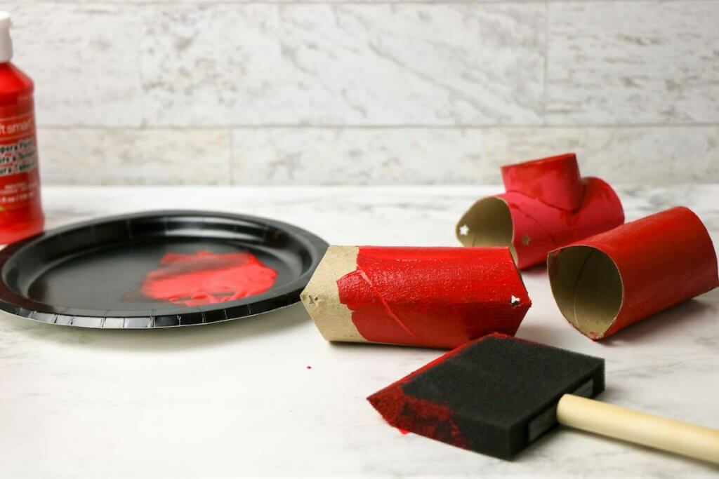Use the red paint to paint your Chinese New Year dragon craft pieces red.
