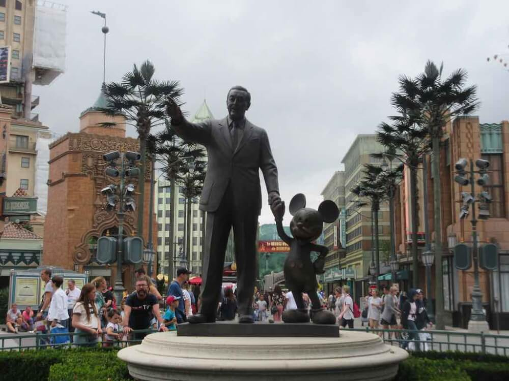 Get to the parks early to take advantage of short ride lines. Image of the Disneyland Paris Walt and Mickey at Studios Park