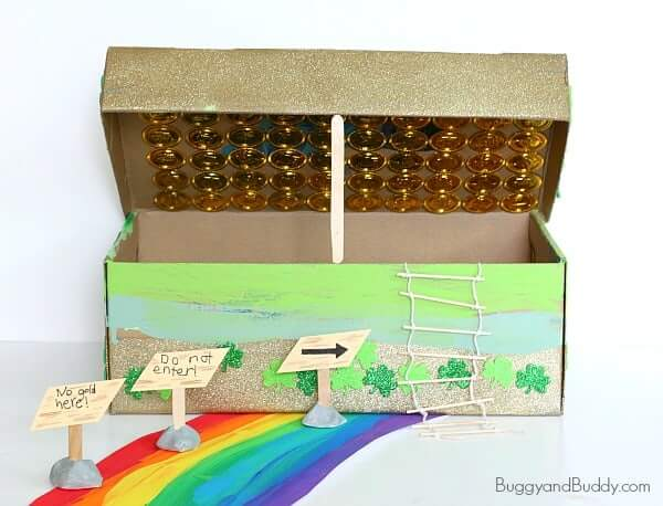 Learn how to trap a leprechaun using these sneaky design techniques. Image of a shoe box decorated with a tiny ladder, tiny signs, and a rainbow path.
