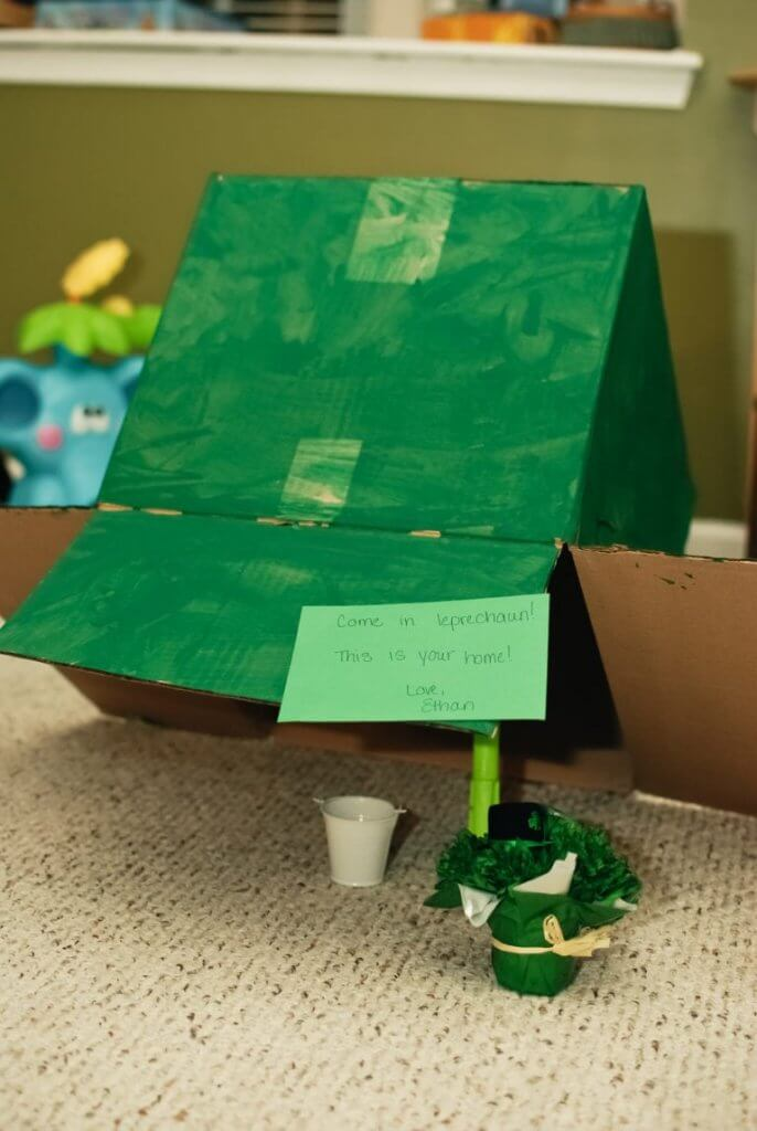 Learn how to trap a leprechaun with this easy leprechaun trap for kids. Image of a green box propped up so a leprechaun can come visit.