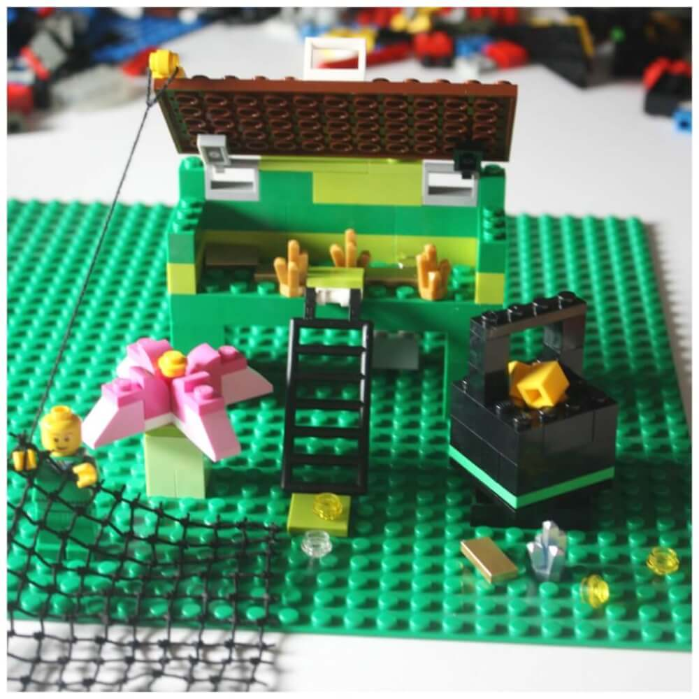 How to make a LEGO leprechaun trap for kids. Image of a bunch of green and black LEGOs.