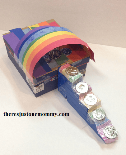 Learn how to make this adorable leprechaun trap project. Image of a shoe box decorated in rainbow colors with money taped to it.