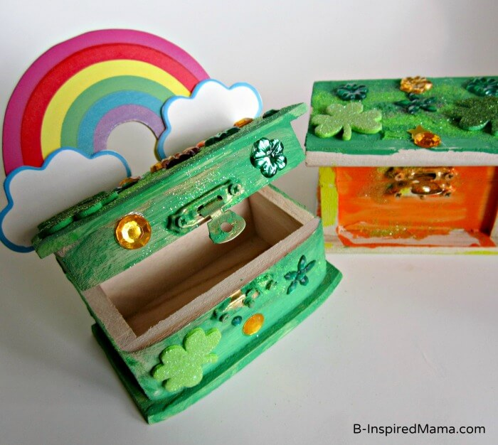 Learn how to make easy leprechaun traps for kids using wooden boxes. Image of wooden jewelry boxes painted in orange and green.