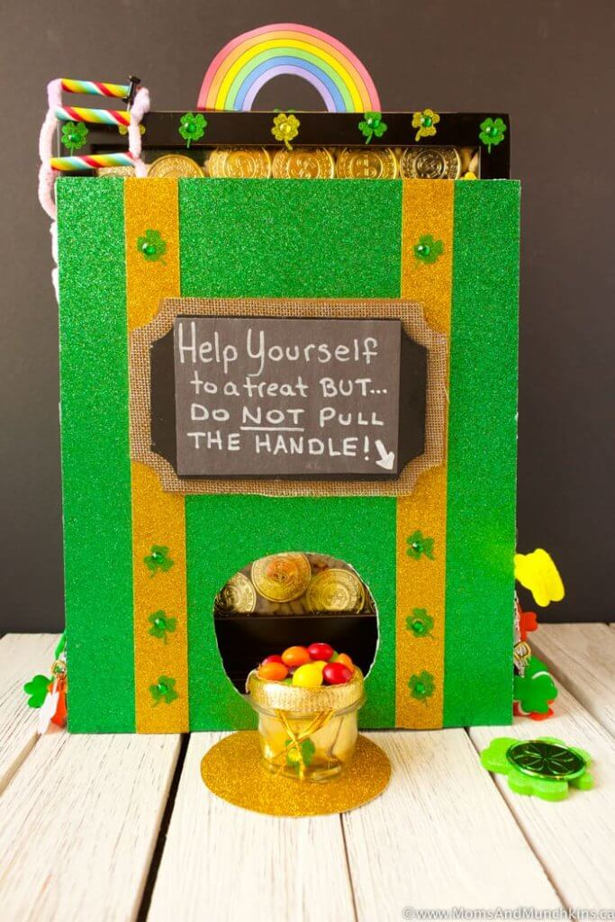This is a super cool DIY leprechaun trap for kids to make. Image of a green box with a sign saying not to pull the handle.