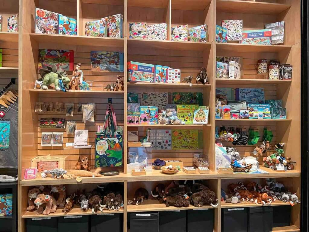 The Burke Museum gift shop is pretty impressive. Image of a shelves filled with animal-related gift items.