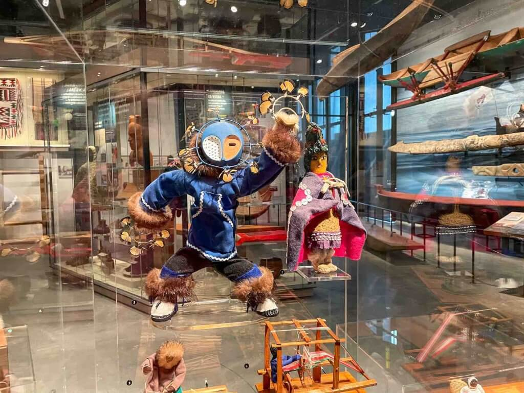Learn about different cultures at this Seattle natural history museum. Image of some cultural dolls at the Burke Museum in Seattle.