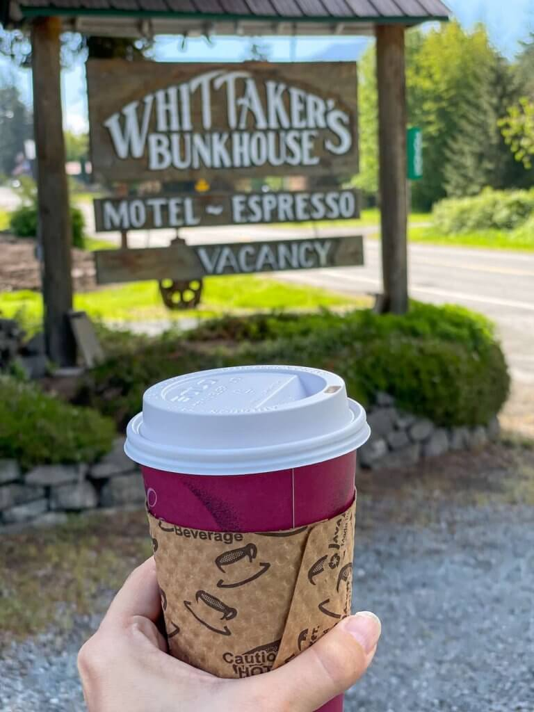 Looking for coffee near Mt Rainier? Whittaker's Bunkhouse has a really nice coffee shop. Image of someone holding a coffee cup.