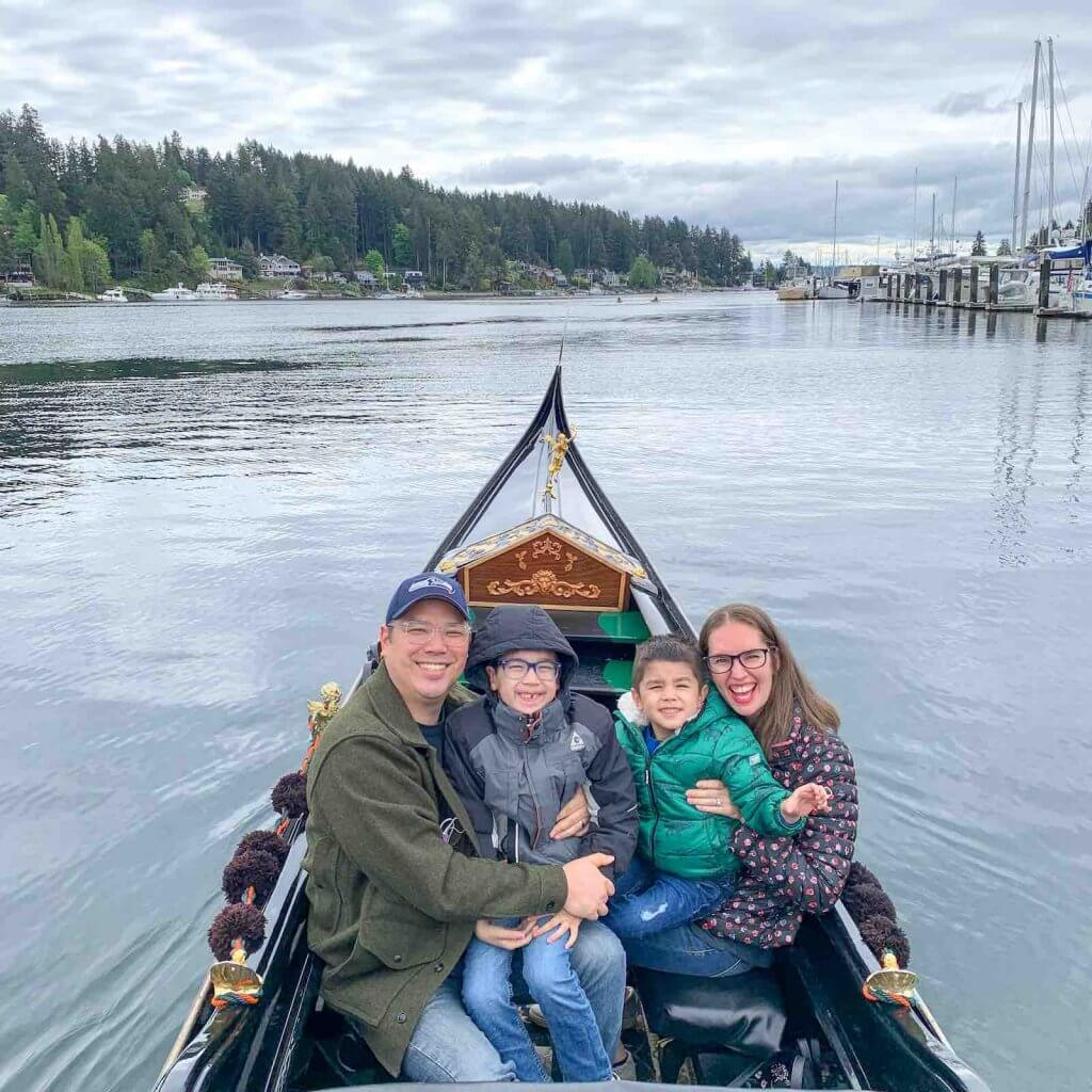 Find out how to ride a Gig Harbor Gondola in Washington State by top Seattle blog Marcie in Mommyland. Image of a family sitting in a gondola at Gig Harbor Washington.