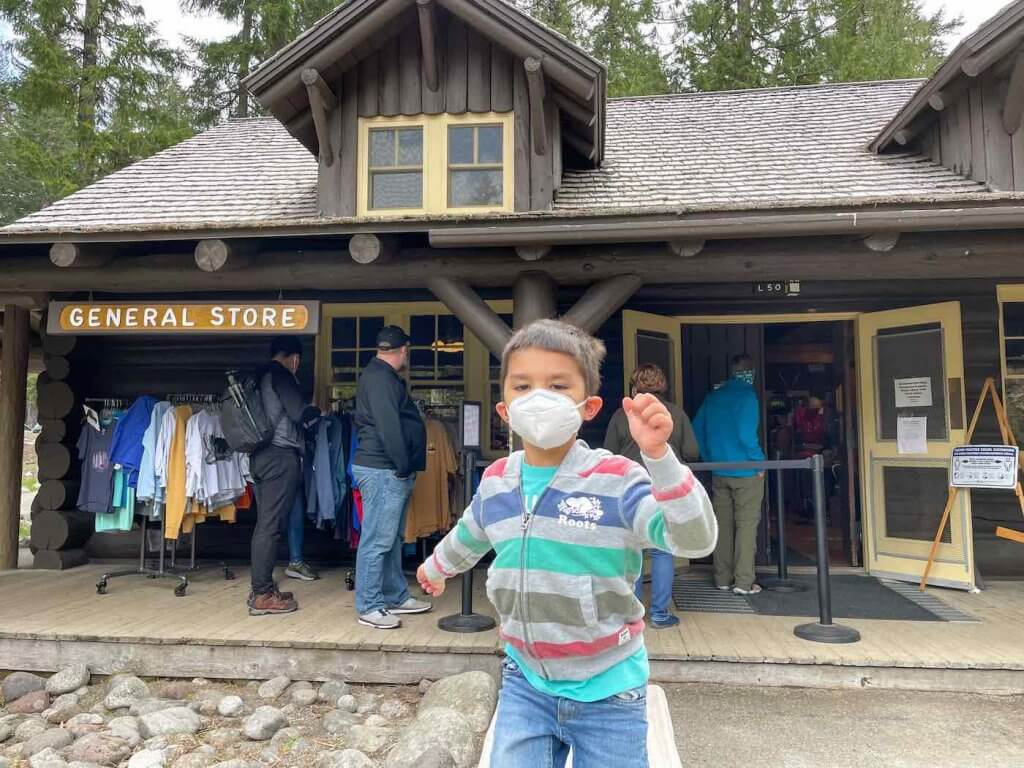 The National Park Inn is a great place for Mt Rainier souvenirs. Image of a boy running in front of a store.