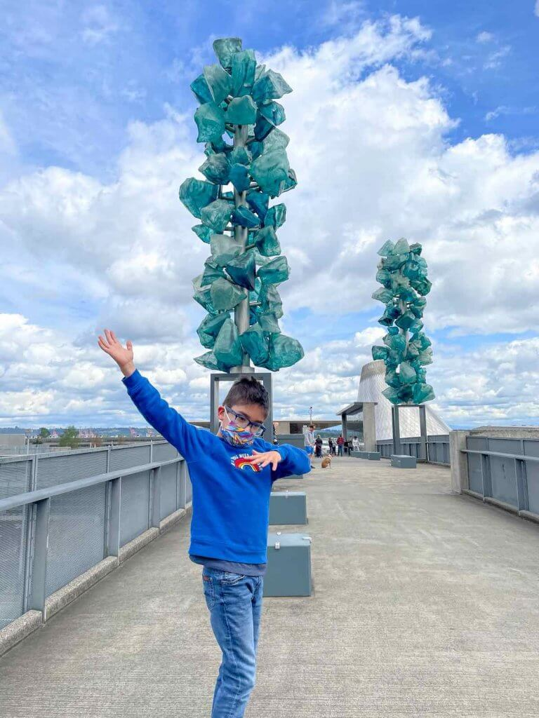 The Bridge of Glass is a top Tacoma attraction. Image of a boy dabbing on the Bridge of Glass.