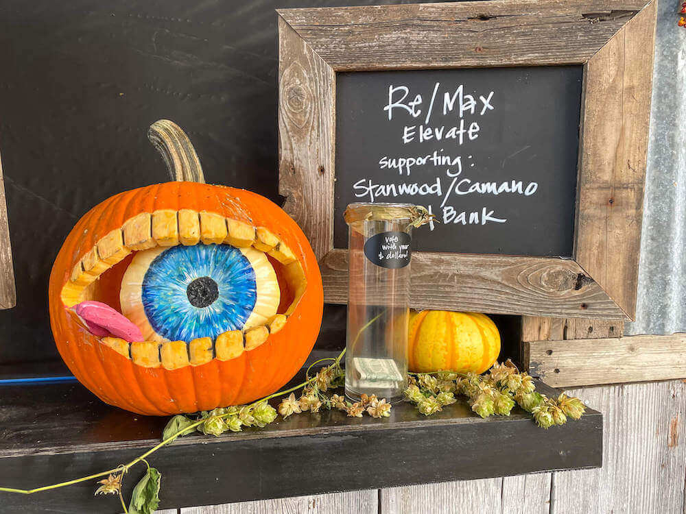 Image of a pumpkin carved to look like there's an eyeball inside it.