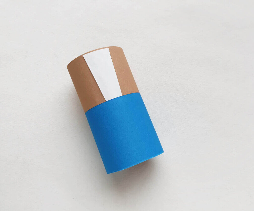 Wrap the paper around the toilet paper roll to create Frankenstein's body.