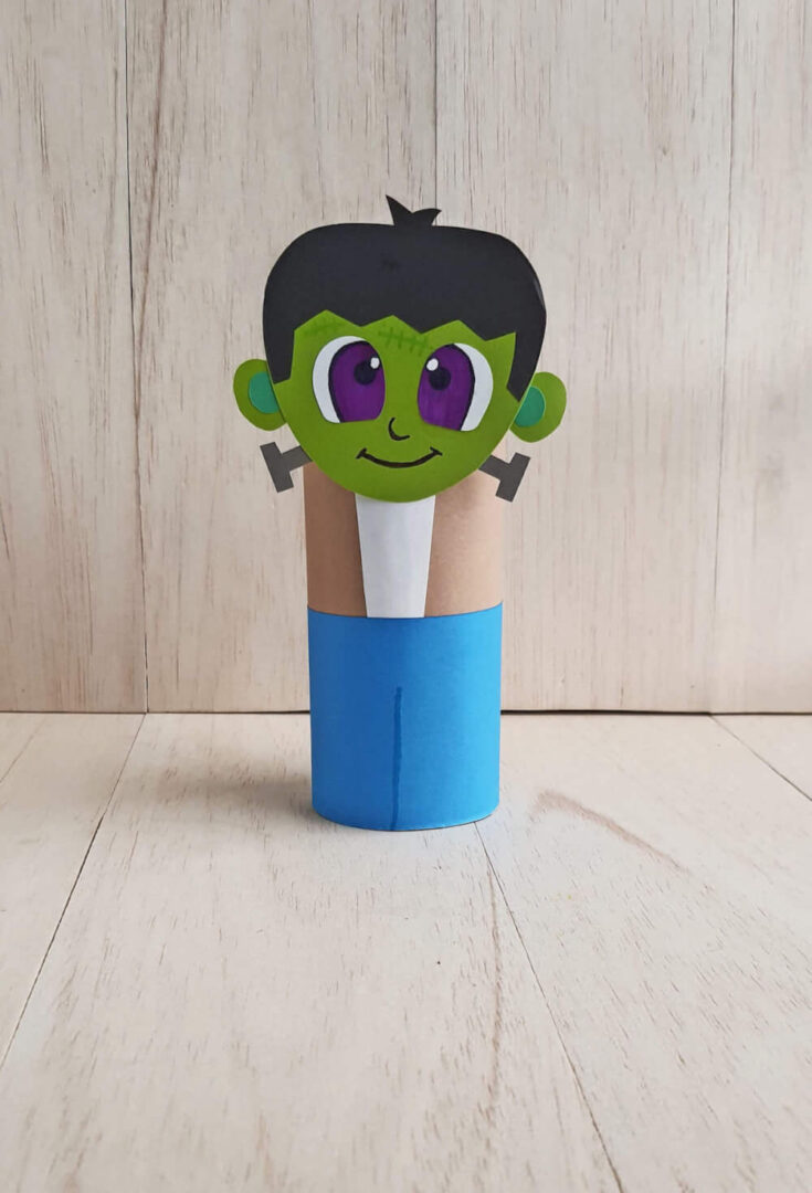 Find out how to make this cute Frankenstein toilet paper roll craft by top Seattle blog Marcie in Mommyland. Image of a Halloween toilet paper roll craft that looks like a loveable Frankenstein.