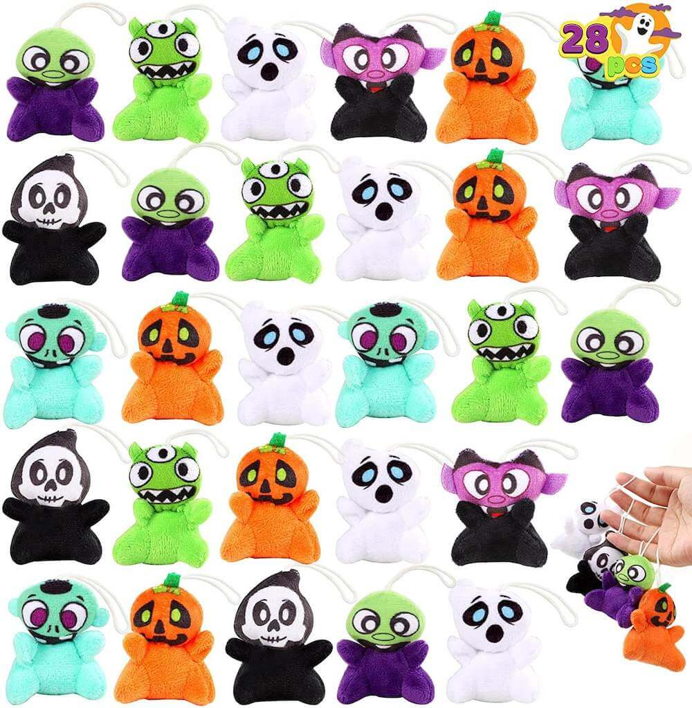 These mini Halloween plush toys are some cute Halloween candy alternatives to give trick-or-treaters this year. Image of Halloween plushies like pumpkins, ghosts, aliens, and more.