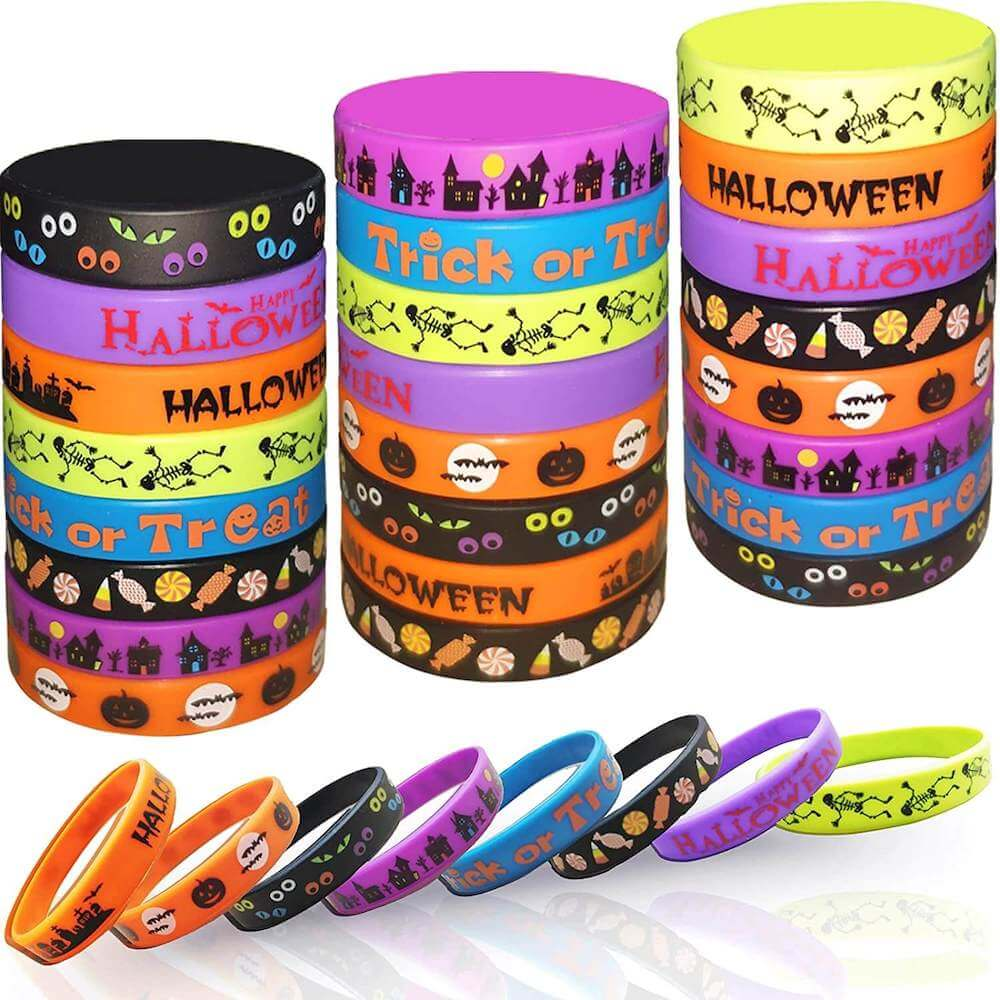 These rubber Halloween bracelets are the perfect non-candy Halloween treats to pass out this year. Image of a bunch of colorful Halloween rubber bracelets.