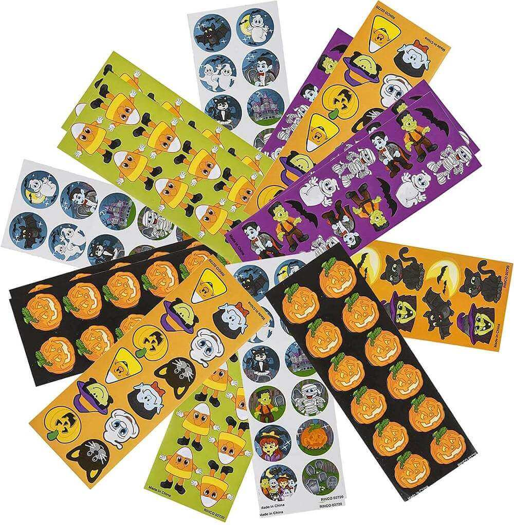 These stickers are fun Halloween handout ideas that aren't candy. Image of a bunch of Halloween stickers.