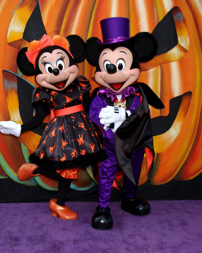 Mickey and Minnie Mouse are all dressed up for Halloween