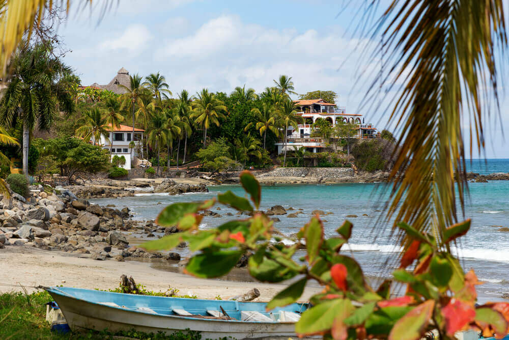 Sayulita is one of the best small towns in Mexico to celebrate Dia de los Muertos. Image of a beachy town in Mexico.