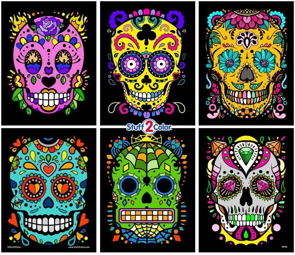 These are cute sugar skulls fuzzy velvet posters celebrating the Day of the Dead. It's a great Halloween craft activity for kids, toddlers, teens, and adults.