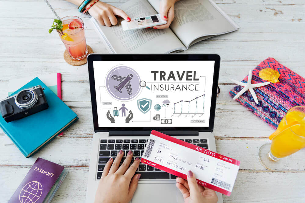 Find out the pros and cons of investing in Hawaii travel insurance for your next Hawaiian vacation. Image of a laptop with travel insurance on the screen.