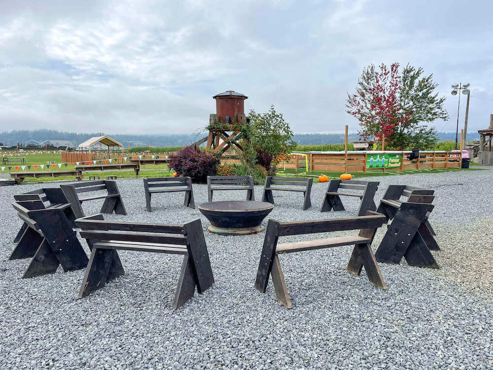 Image of bench seats around a fire pit.
