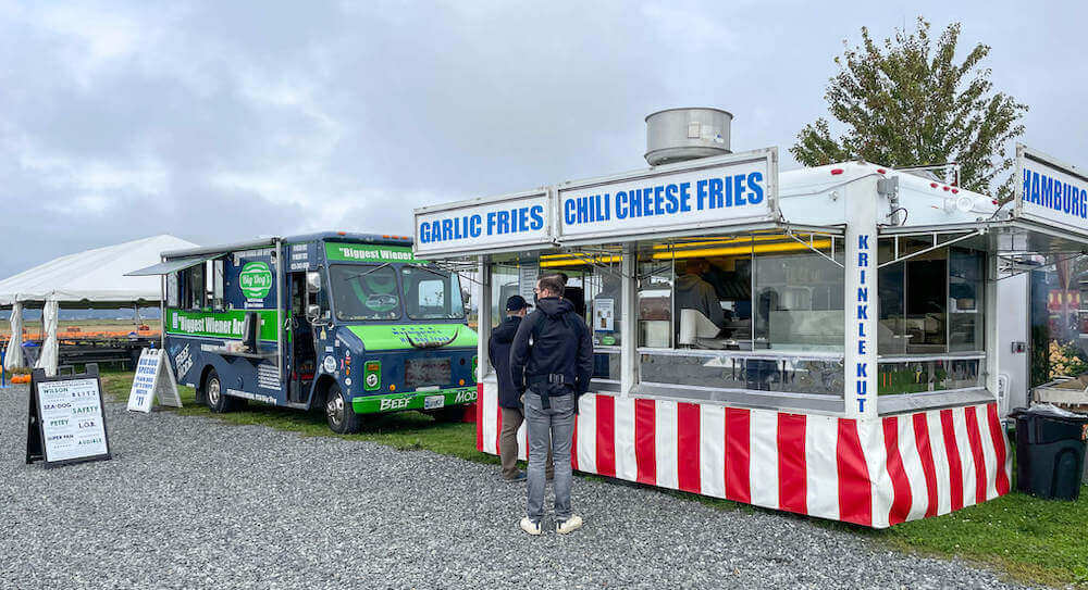 Image of a burger and fries food booth and hot dot truck at a pumpkin patch in Washington state.