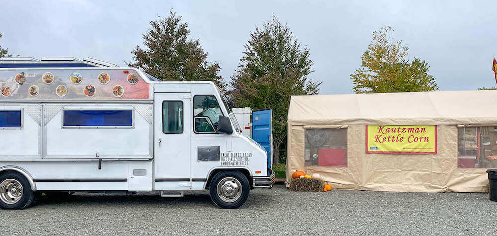 Image of a taco truck and kettle corn tent.