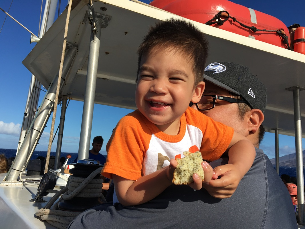 Owen enjoying his muffin as we set sail on the Four Winds Maui