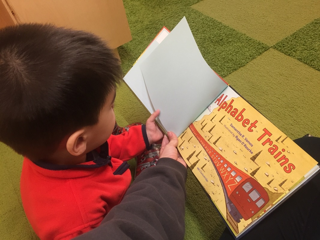 Reading at KidsQuest Museum