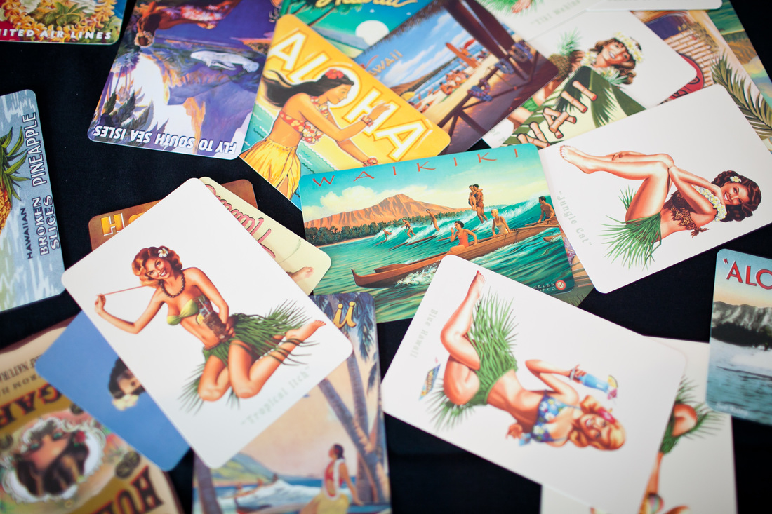 Photo of vintage Hawaiian postcards used for a travel themed wedding guest book idea. #diywedding #weddingguestbook #weddinginspo #travelthemedwedding