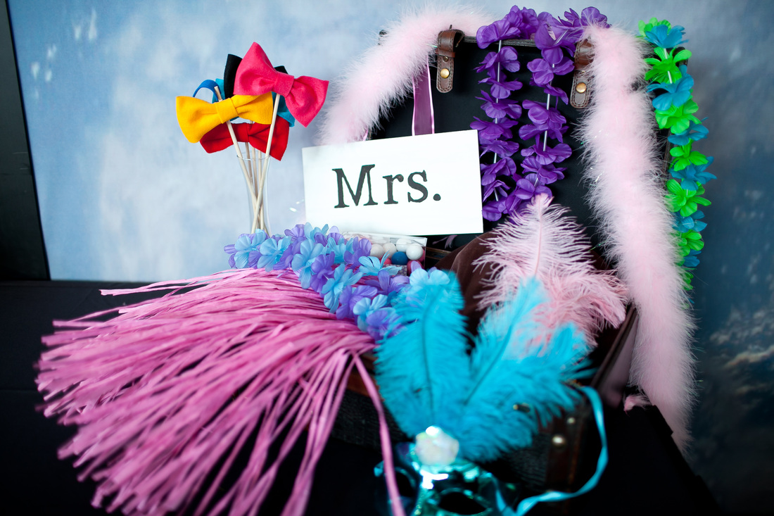 Photo of wedding photo booth props for a travel themed wedding in Seattle. #diywedding #photobooth #seattlewedding #travelthemedwedding