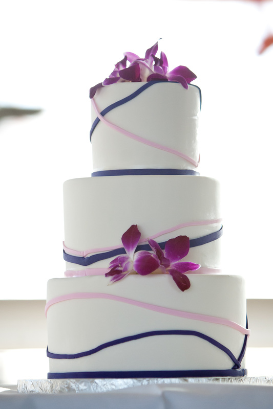 Photo of a Hawaiian wedding cake topped with orchids for a travel themed wedding in Seattle. #weddingcake #weddinginspo #travelthemedwedding