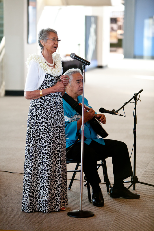 Photo of Hawaiian musicians playing the Hawaiian Wedding Song at our travel themed wedding in Seattle. #hawaiianwedding #travelthemedwedding #diywedding