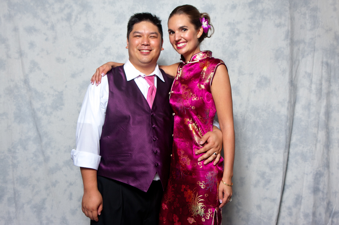 Photo of a bride in a Chinese cheongsam at a travel themed wedding. #cheongsam #chinesewedding #travelthemedwedding