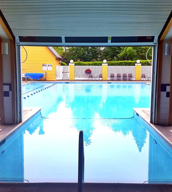 Photo of the Semiahmoo Resort pool, which is both indoor and outdoor and is perfect for a family vacation #semiahmoo #pool #pnw #pacificnorthwest